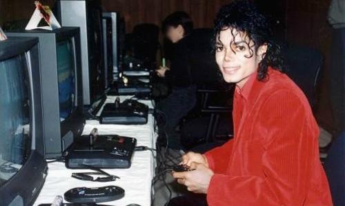 "Michael Jackson playing on the Mega Drive during his ""Bad"" Tour"