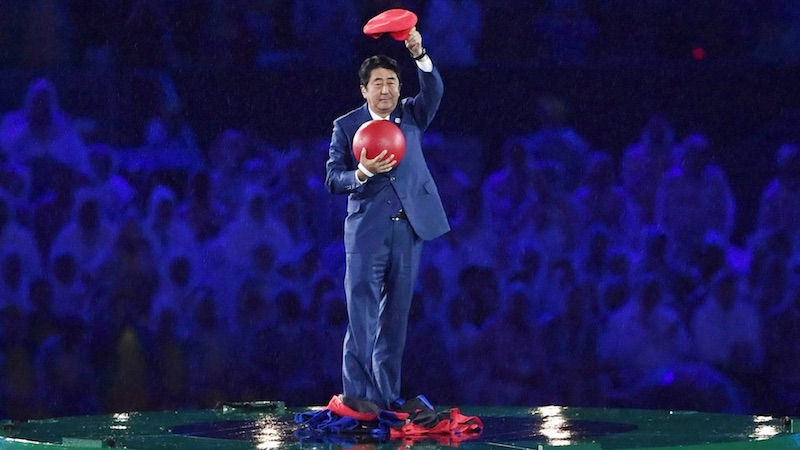 Shinzo Abe appears from the Warp Pipe cosplaying as Super Mario.